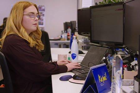 Alanah-sitting-at-her-desk