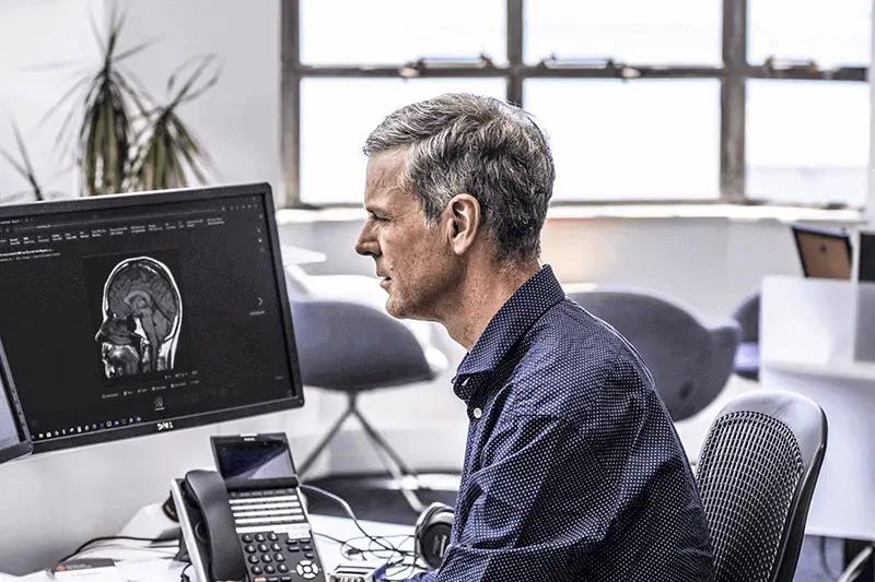 Dr-Richard-Medlicott-looking-at-computer-screen