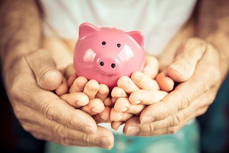 Family-holding-piggy-bank-for-the-value-of-financial-resilience.jpg
