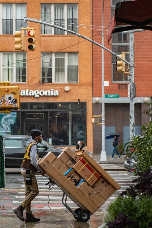 Guy-transporting-parcels-in-front-of-Patagonia-shop-by-Wynand-Van-Poortvlie-on-Unsplash.jpg