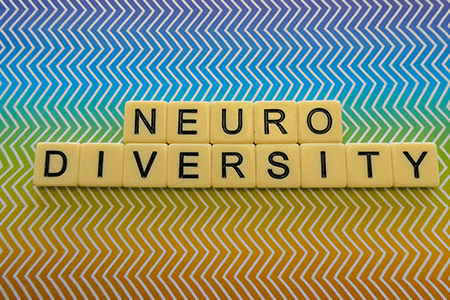 Neurodiversity-spelt-in-scrabble-letters-with-rainbow-zig-zag-background-listing