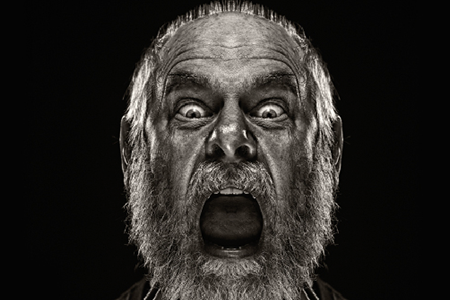 black-and-white-photo-of-bearded-old-man-with-mouth-wide-open