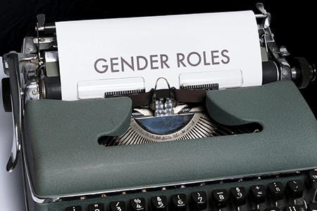 green-and-white-typewriter-with-text-gender-roles-written-on-paper