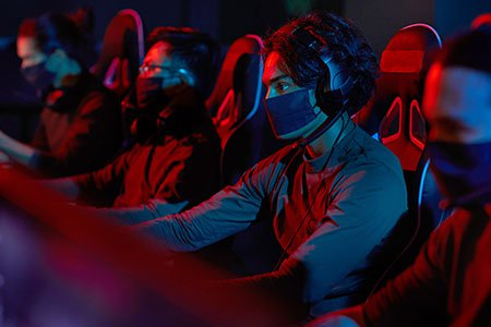 group-of-hackers-sitting-at-computers-wearing-facemasks