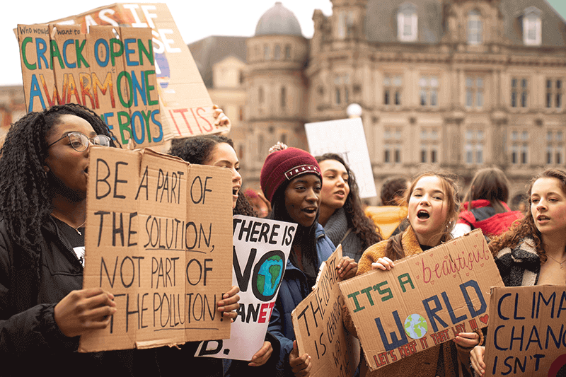 group-of-young-people-protesting-against-climate-change-with-signboards