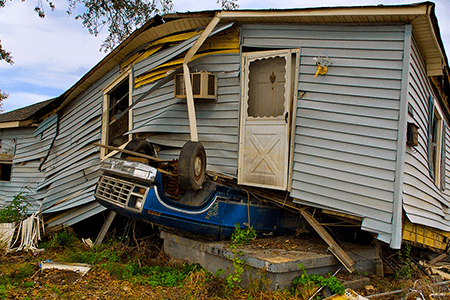 house-uplifted-and-landing-on-top-of-car-in-natural-disaster-listing-image