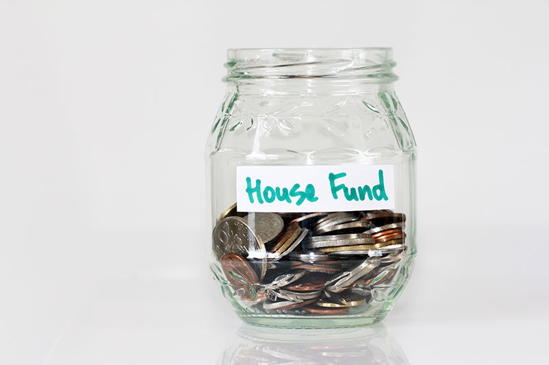 Jar of coins labelled house fund