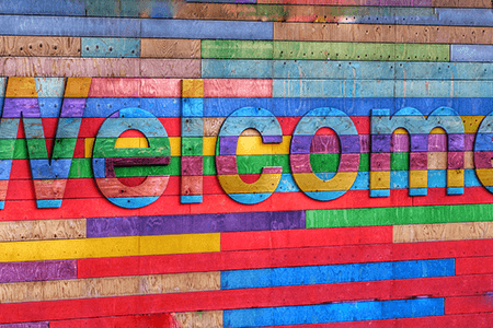 multicoloured-wooden-welcome-sign-listing-image.png