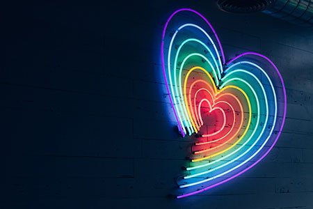 mutlicoloured-heart-LED-light-on-wall