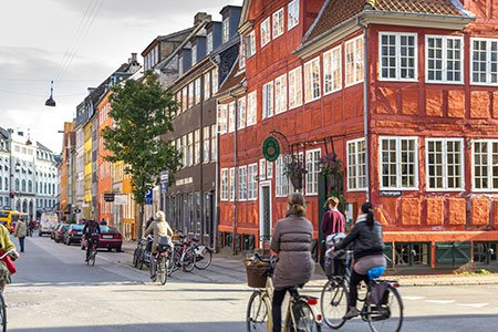 people-riding-bikes-along-the-streets-in-Copenhagen