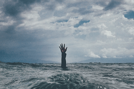 photo-of-hand-reaching-out-from-choppy-waves-listing-image