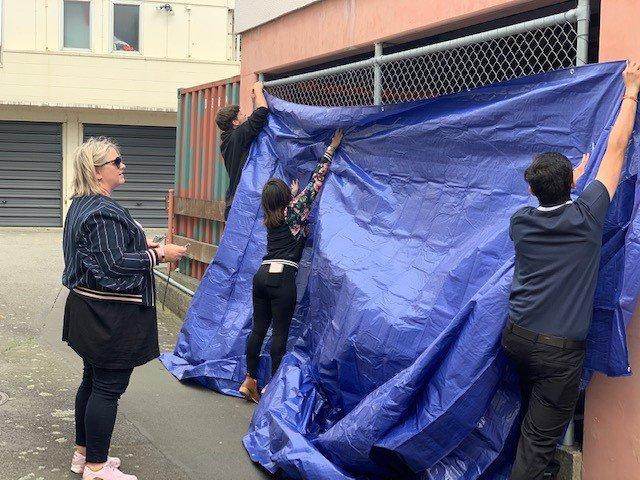 placing the tarp