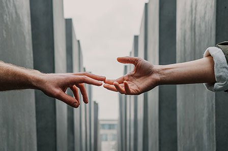 two hands reaching out to each other byToa Heftiba-Unsplash