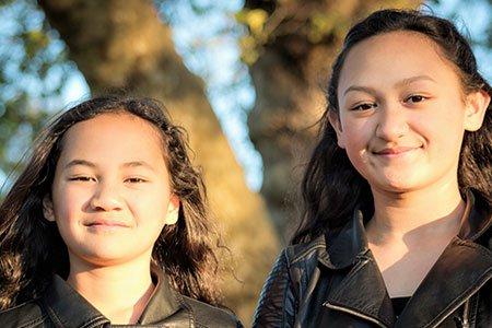 two-young-maori-girls-outside