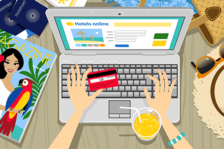woman-entering-her-credit-card-details-on-laptop-while-drinking-a-cocktail-listing