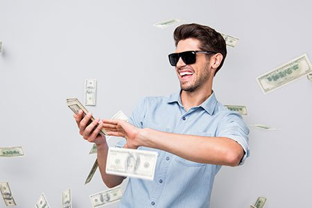 young-cool-man-throwing-money