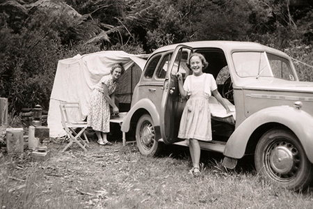 young-family-with-car-and-camping-listing-image.png